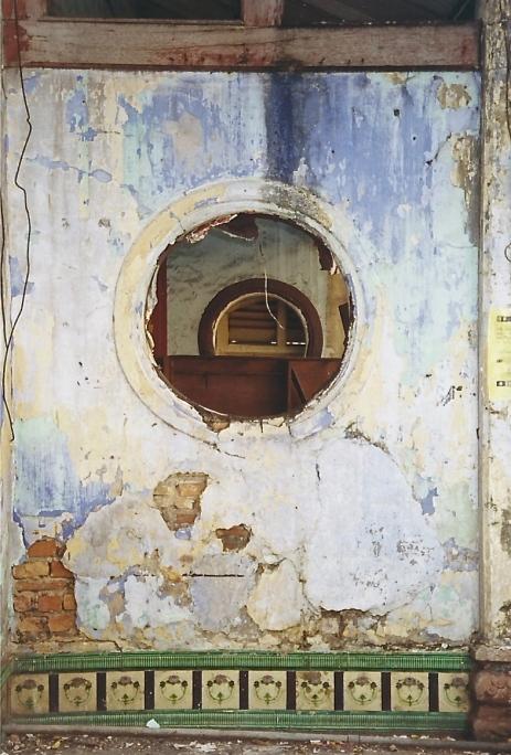 Through the ruined window