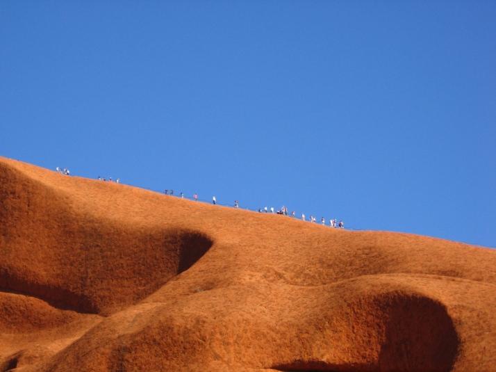 Climbers on Uluru, rplzzz